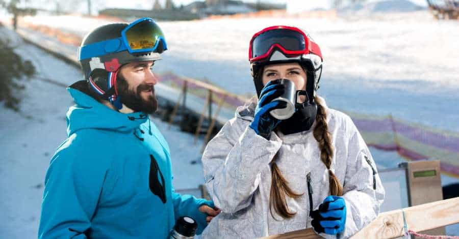 snowboarder and skier drinking