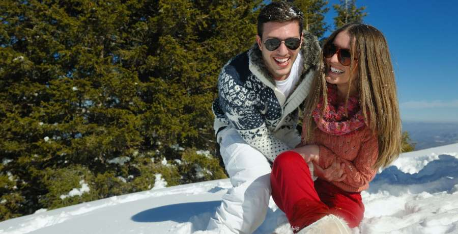 happy couple on a snowy ski mountain
